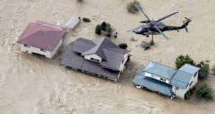 An aerial view shows a Japan Self-Defence Force helicopter flying over residential areas flooded by the Chikuma river following Typhoon Hagibis in Nagano