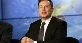 FILE - In this  Sunday, Jan. 19, 2020, file photo, Elon Musk founder, CEO, and chief engineer/designer of SpaceX speaks during a news conference after a Falcon 9 SpaceX rocket test flight to demonstrate the capsule's emergency escape system at the Kennedy Space Center in Cape Canaveral, Fla. Tesla confirmed Thursday, May 28, that CEO Musk will get the first tranche worth nearly $770 million of a stock-based compensation package triggered by the company meeting several financial metrics. (AP Photo/John Raoux, File)